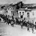 Armenians are marched out of Harput by Turkish soldiers.