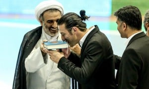 Ando kissing the Quran