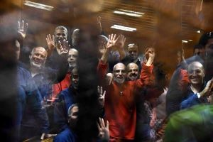 Mohamed Badie, the spiritual leader of the Muslim Brotherhood, center right, was among the defendants in the Cairo courtroom on Tuesday. Credit Ali Malki/Almasry Alyoum, via European Pressphoto Agency