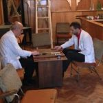Two barbers take a break with some backgammon.
