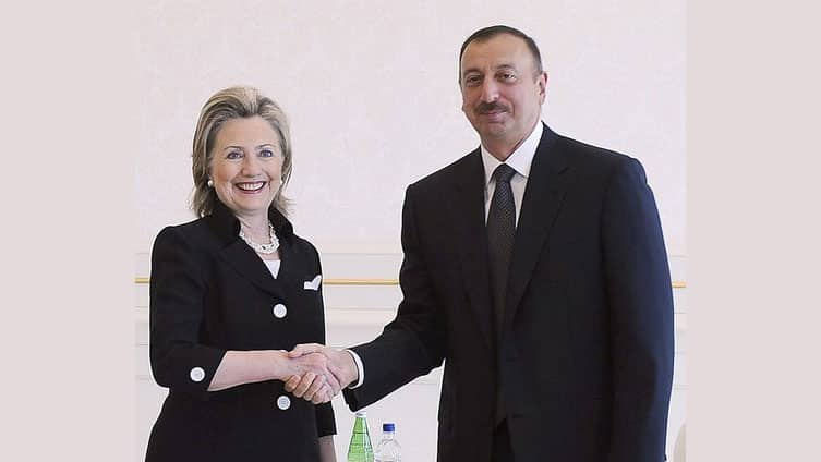 U.S. Secretary of State Hillary Clinton (L) shakes hands with Azerbaijan's President Ilham Aliyev during their meeting in Baku, July 4, 2010.