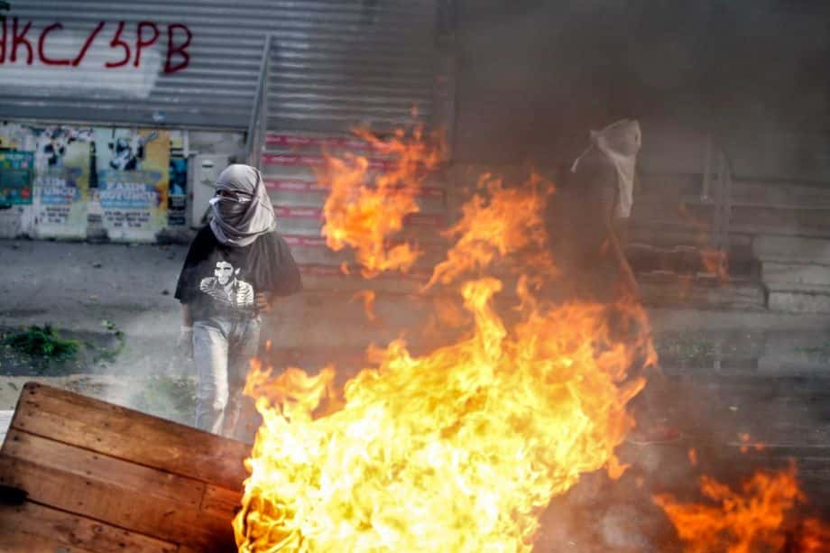 Masked leftist militants clash with security forces during a protest in Gazi district in Istanbul, Turkey, Sunday, Aug. 23, 2015.