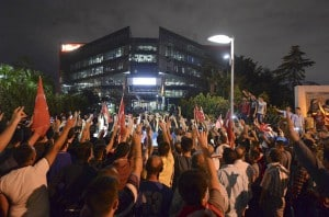 Demonstrators shout nationalist slogans during a protest in front of the headquarters of the Hurriyet daily newspaper in Istanbul, Turkey, September 8, 2015.