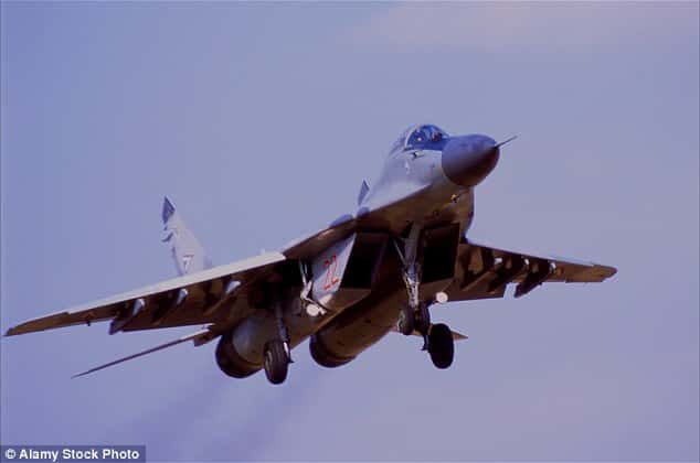 Turkish forces have shot down a Russian jet after it flew into the country's airspace, according to unconfirmed reports on social media. Pictured is a MIG-29 jet belonging to the Russian Air Force