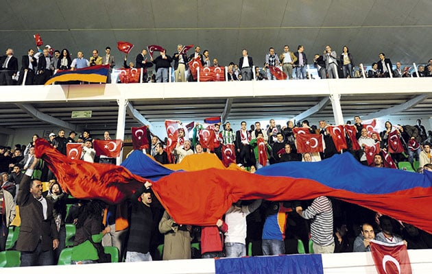 Pride…Armenian fans unfurl their national flag in the Ataturk Stadium before the game in Turkey