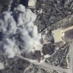 A video grab made on November 23, 2015 shows an explosion after airstrikes by the Russian air force against a militant base in Syria's northwestern province of Idlib