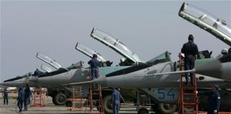 The photo shows Russian Air Force technicians preparing MiG-29 fighter jets in Primorsko-Akhtarsk, Krasnodar region