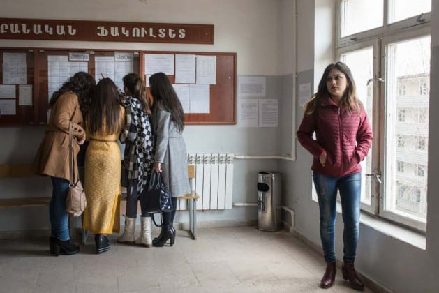 A group of female students check their class schedule during a break at Artsakh State University in the NKR. A degree here will only have value in the NKR and Armenia, since the NKR's self-declared independence has not been recognized by neighboring countries. KARL MANCINI, GIANMARCO MARAVIGLIA/ECHO