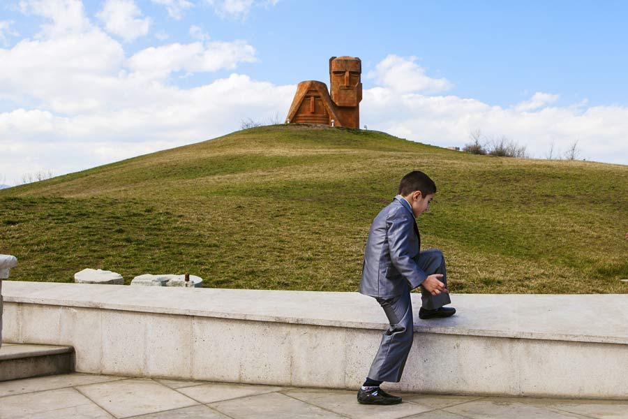 Children from a local private school visit the Tatik-Papik monument, also known as