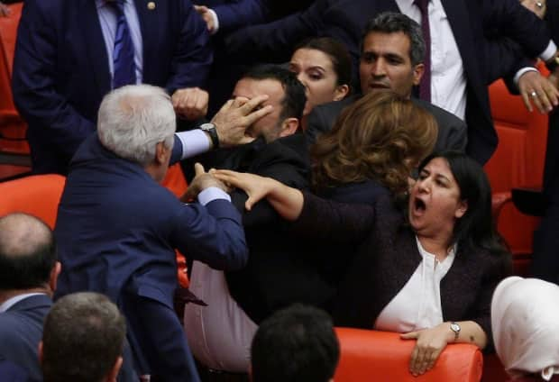 Ruling AK Party and pro-Kurdish Peoples' Democratic Party lawmakers scuffle during a debate at the Parliament in Ankara, Turkey late April 27, 2016. — Reuters pic