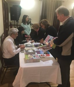 At the book signing table